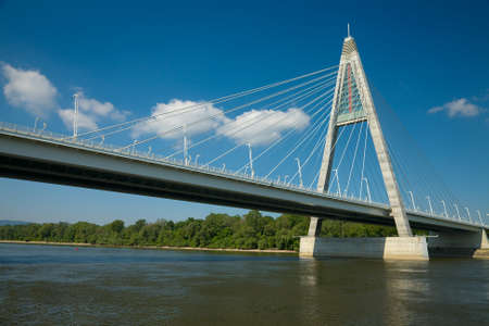 Cable-stayed bridge over a river photo