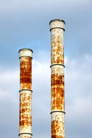 Rusty metal chimneys of a factory photo