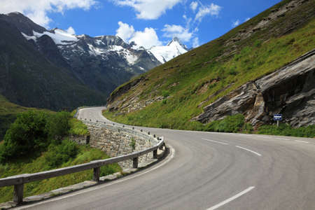 rough road: Alpine road between high mountains