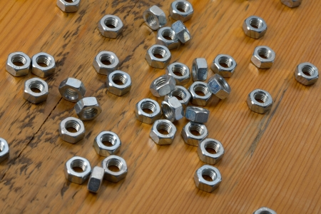 Shiny metal nuts on a table photo