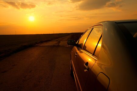 parked: Car on the roadside in the sunset
