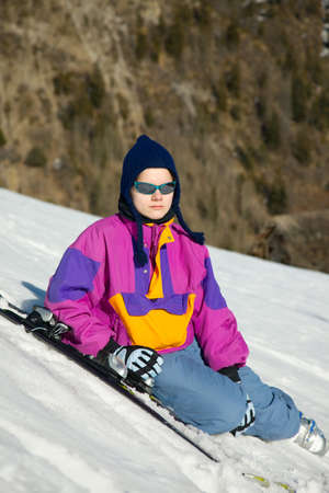 Young female skier sitting and relaxing Stock Photo - 15892427