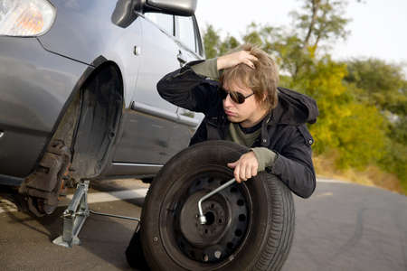 Man changing wheel on a car Stock Photo - 16140923