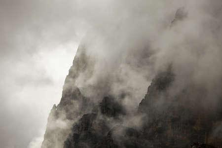 invincible: Foggy mountain cliffs of a steep ridge