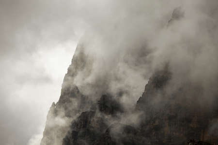 Foggy mountain cliffs of a steep ridge Stock Photo - 16221356