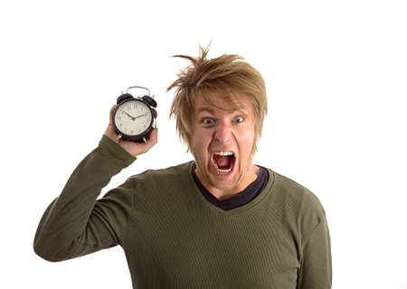 Yelling man with alarm clock in hand Stock Photo