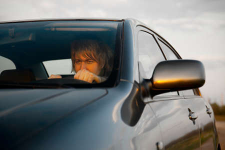 Man driving a car recklessly Stock Photo - 16640817