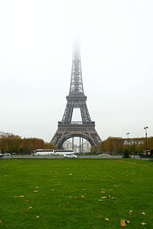 The Eiffel Tower with the top disappearing in the fog Stock Photo - 16662841