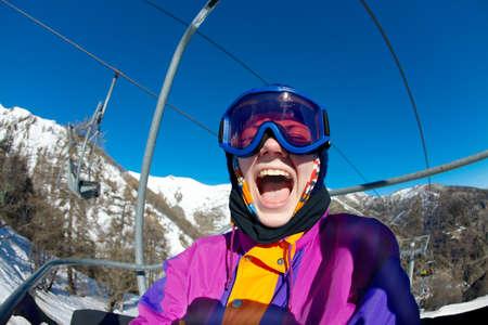 Female skier having fun on the lift Stock Photo - 16640815