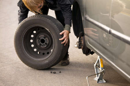 Changing wheel on a car on the roadside Stock Photo - 16824369