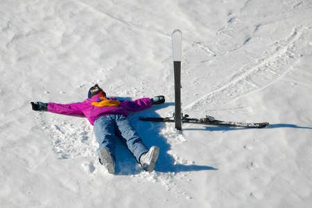 Female skier relaxing in the snow Stock Photo - 16824368