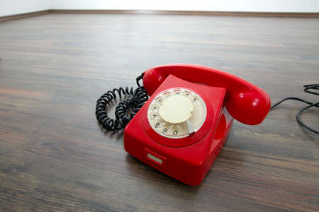 Red telephone on the floor Stock Photo - 16839699