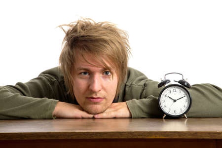 oversleep: Male portrait with alarm clock Stock Photo