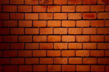 Red brick wall in artificial light photo
