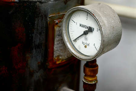 Manometer on an old rusty gas tank Stock Photo - 17973688