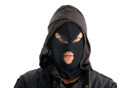 trespasser: Aggressive masked figure ready to commit crimes Stock Photo