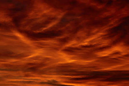 Red, cloudy sky at sunset photo