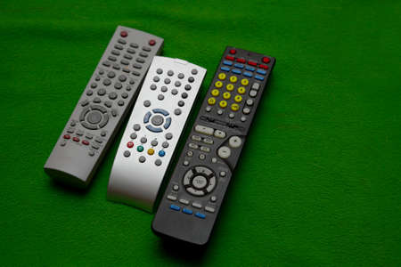 remote controls: Remote controls on a couch