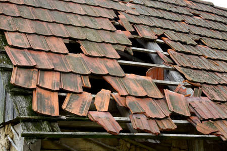 Damaged roof of an old rural house photo