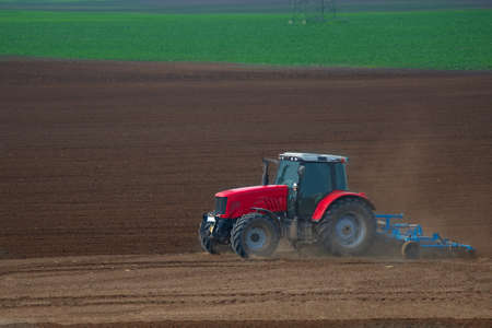 industrialized country: Tractor plowing the fields