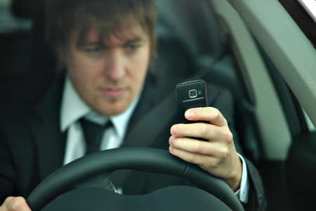 Man texting and driving Stock Photo