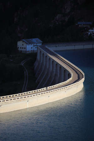 reservoir: Dam in twilight at lake Fedaia