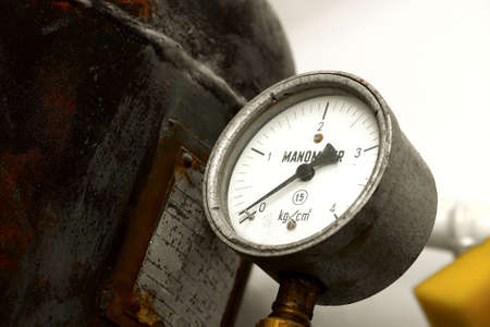 corrosion: Old rusty manometer on a gas container