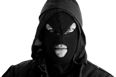 trespasser: Black masked figure portrait Stock Photo