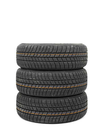 New winter tyres in a pile photo