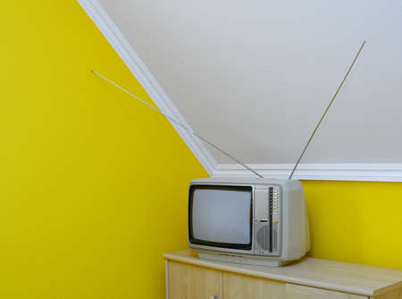 Old, vintage tv set in the corner of the room Stock Photo - 18661246