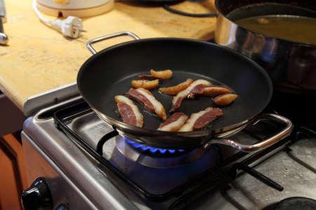 Preparing food on a stove photo