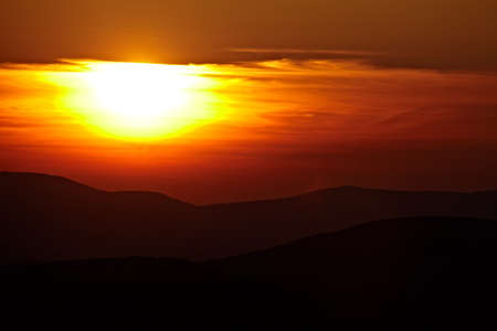spiritual background: Cloudy sunset in the mountains