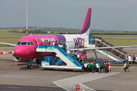 BUDAPEST, HUNGARY - MAY 5: Passengers boarding a Wizzair airliner at Budapest Liszt Ferenc Airport, May 5th 2012. Wizzair is a rapidly growing low-cost carrier based in Hungary.