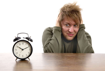 despaired: Man annoyed by the alarm clock Stock Photo