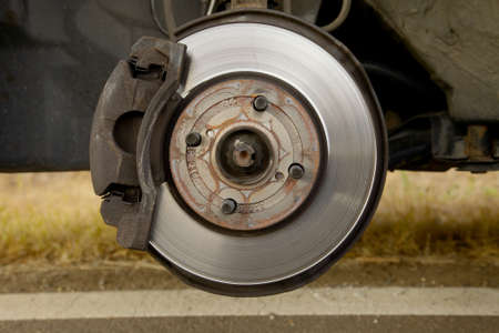 Brakes on a car with removed wheel photo