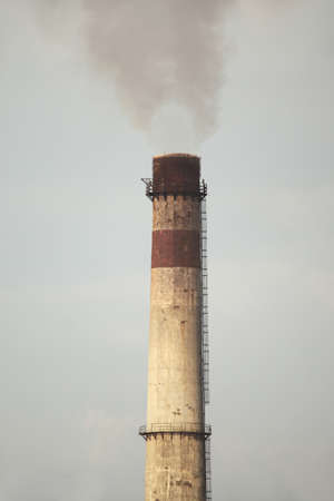 Smoking chimney of an industrial plant photo