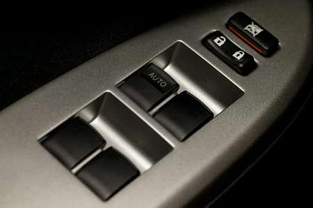 ergonomics: Window adjustment buttons on a car
