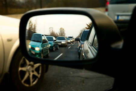 sideview: Traffic jam in the sideview mirror of a car