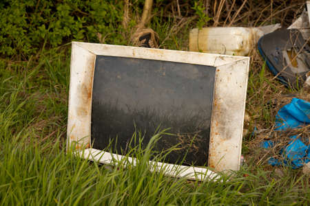 discarded: Discarded old TV set on a field Stock Photo