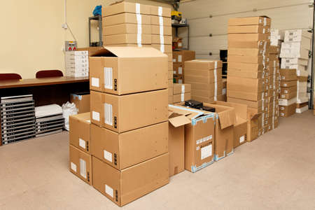 delivery room: Small warehouse with cardboard boxes Stock Photo