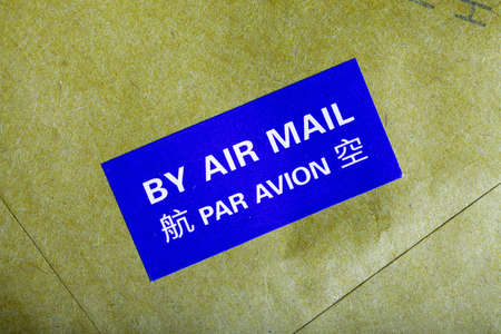 By air mail sticker on a letter photo