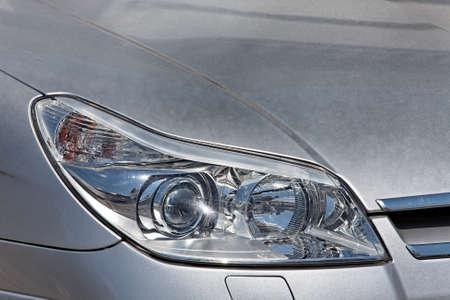 Closeup of the headlights of a car photo