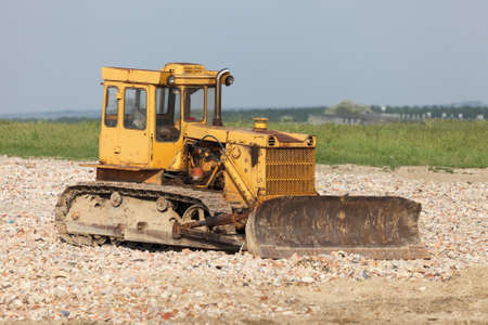 decadence: Old excavator machine at a construction site Stock Photo
