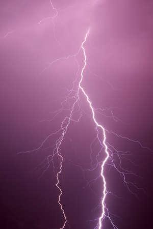 Lightning in the evening sky photo