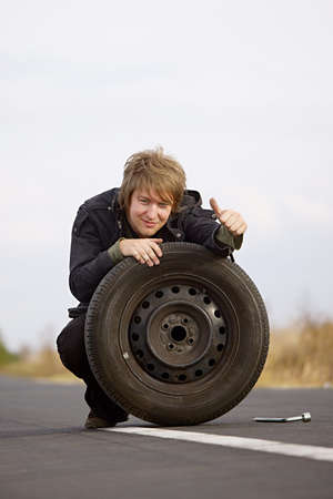 Man changing wheels being cheerful photo