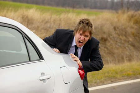 Pushing a broken down car photo