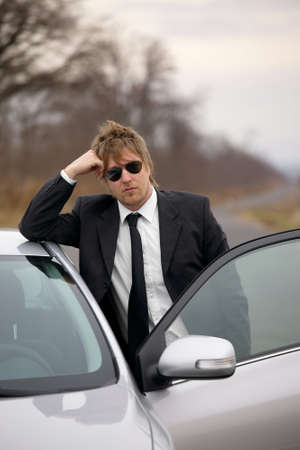 break down: Driver of a car standing and waiting