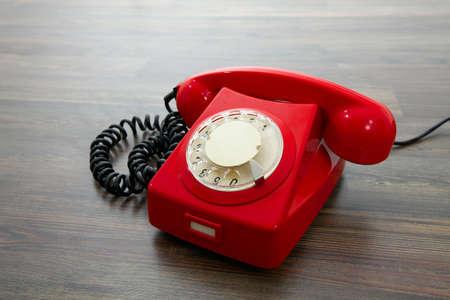 hangup: Red vintage telephone on the floor