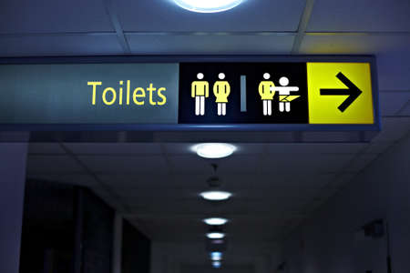 Toilets sign in a building corridor Stock Photo - 20189524