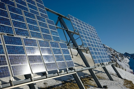 Big cluster of solar panels on a mountain peak Reklamní fotografie